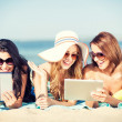Girls with tablet pc on the beach — Stock Photo #46601263