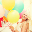 Smiling woman with colorful balloons — Stock Photo #46601379