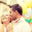 Happy couple with colorful balloons — Stock Photo #46601381