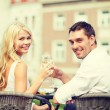 Smiling couple drinking wine in cafe — Stock Photo #46601531