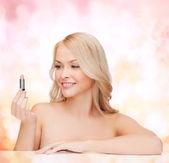 Beautiful woman with pink lipstick — Stock Photo