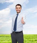 Stilig affärsman visar tummen — Stockfoto