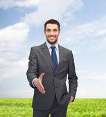 Affärsman med öppen hand redo för handskakning — Stockfoto