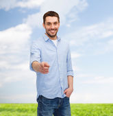 Smiling man pointing finger at you — Stock Photo