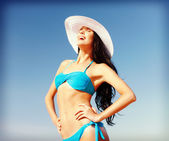 Girl in bikini standing on the beach — Stock Photo