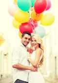 Couple with colorful balloons — Stock Photo