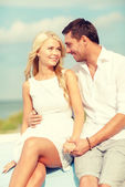 Smiling couple at sea side — Stock Photo