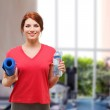 Smiling girl with bottle of water after exercising — Stock Photo #46612637