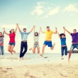 Group of friends jumping on the beach — Stock Photo #46613207