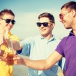 Group of male friends having fun on the beach — Stock Photo #46616313