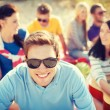 Smiling man in sunglasses on the beach — Stock Photo #46618799
