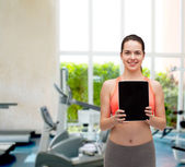 Sporty woman with tablet pc blank screen — Stock Photo