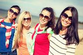 Beautiful teenage girls having fun on the beach — Stock Photo