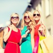 Beautiful women with shopping bags in the ctiy — Stock Photo #46624399