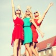 Three beautiful women in the city — Stock Photo #46625259