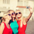 Three beautiful girls taking picture in the city — Stock Photo #46625269