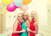 Beautiful girls with colorful balloons in the city — Stock Photo