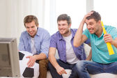 Happy male friends with football and vuvuzela — Stock Photo