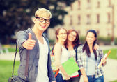 Male student in eyglasses showing thumbs up — Stock Photo
