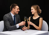 Couple with glasses of champagne at restaurant — Foto de Stock
