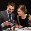 Smiling couple eating main course at restaurant — Stock Photo #46752027