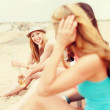 Girls with drinks on the beach — Stock Photo #46754427