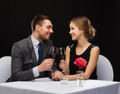 Young couple with glasses of wine at restaurant — Foto de Stock