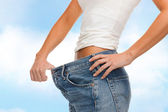 Close up of female showing big jeans — Stock Photo