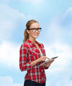Smiling girl in eyeglasses with tablet pc computer — Stok fotoğraf