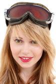 Smiling teenage girl in snowboard goggles — Stock Photo