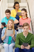 Busy students with tablet pc computer — Stock Photo