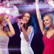 Three smiling women dancing in the club — Stock Photo #46943643
