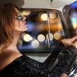 Glamorous woman behind the wheel in the car — Stock Photo