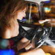 Glamorous woman behind the wheel in the car — Stock Photo #46943783
