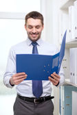 Businessman with folder at office — Stock Photo
