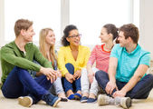 Five smiling teenagers having fun at home — Stock Photo