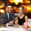 Couple with glasses of champagne at restaurant — Stock Photo #46962787