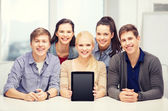 Smiling students with blank tablet pc screen — Stock Photo