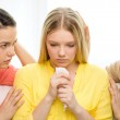 Two teenage girls comforting another after breakup — Stock Photo #47015295