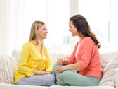 Two girlfriends having a talk at home — Stock Photo