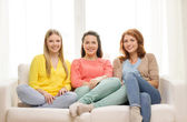 Three girlfriends having a talk at home — Stock Photo