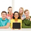 Smiling students showing tablet pc blank screen — Stock Photo #47042519