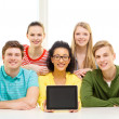 Smiling students showing tablet pc blank screen — Stock Photo #47042543