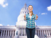 Young woman in casual clothes showing thumbs up — Stock Photo