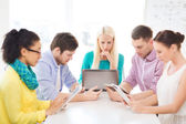 Serious team with table pc and laptop in office — Stock Photo