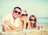 Happy family on the beach — Stock Photo