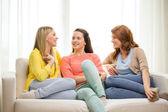 Three girlfriends having a talk at home — Stock Photo