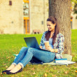 Teenager in eyeglasses with laptop and coffee — Foto de Stock
