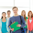 Smiling students with teenage boy in front — Stock Photo #47458745