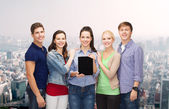 Students showing blank tablet pc screen — Stock Photo